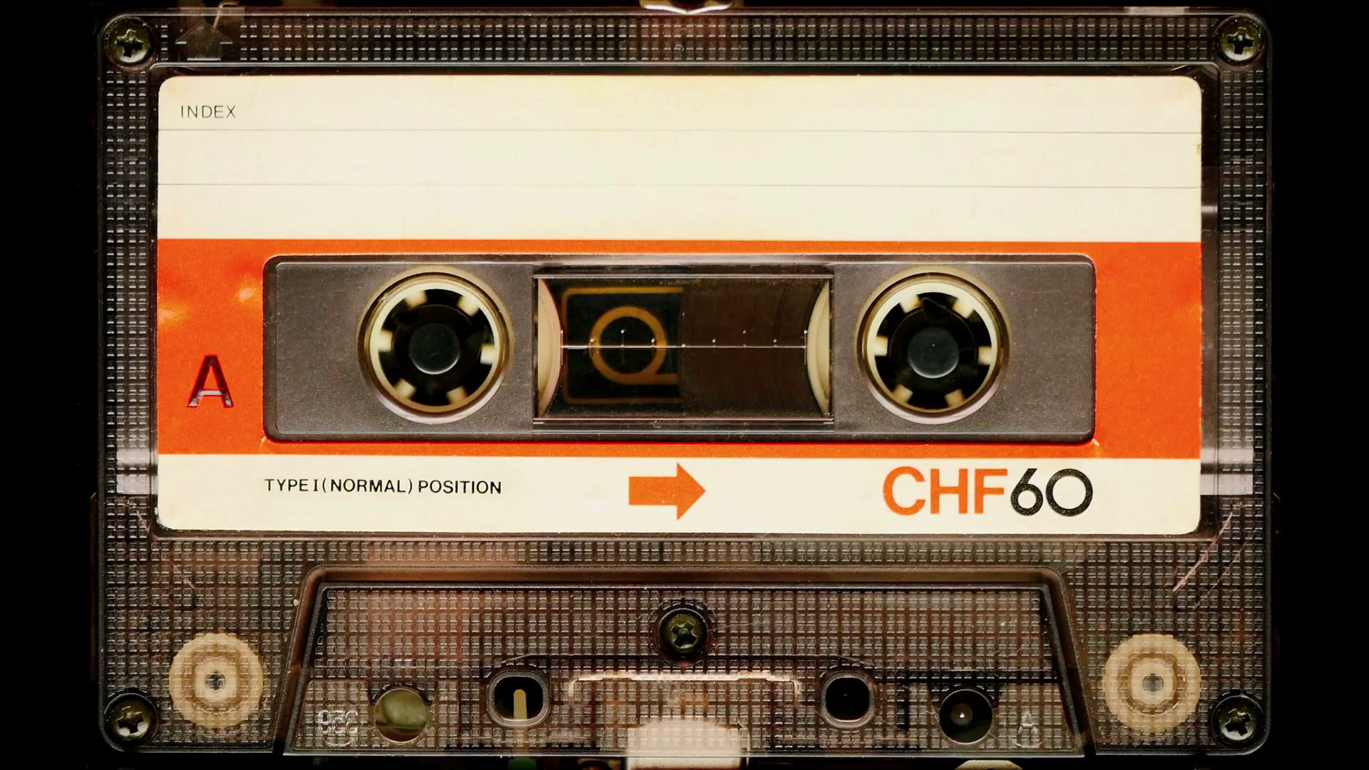 videoblocks-audio-cassette-tape-in-use-sound-recording-in-the-tape-recorder-vintage-music-cassette-with-a-blank-white-label-playing-back-in-the-player-4k-static-camera-shot_rq-2fbqq9x_th